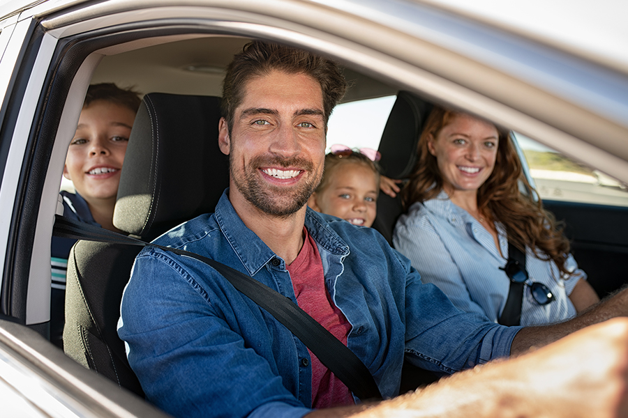 Personal Insurance - Closeup Portrait of a Happy Family Getting Ready for a Road Trip in the Car